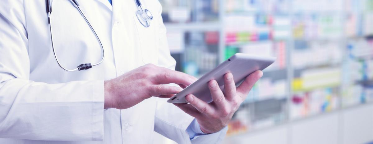 doctor looking at tablet