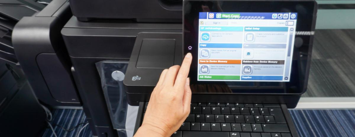 multifunction copier touch screen in use