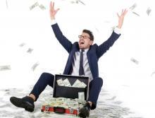 Man in office making money